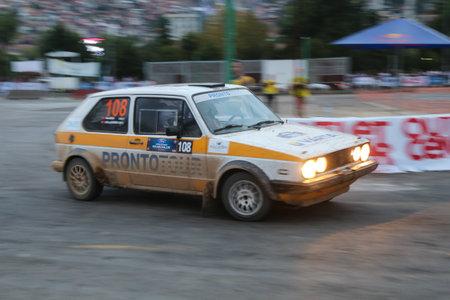 gti: KOCAELI, TURKEY - AUGUST 22, 2015: Gokhan Sahinoglu with VW Golf GTI in special stage of Kocaeli Rally 2015