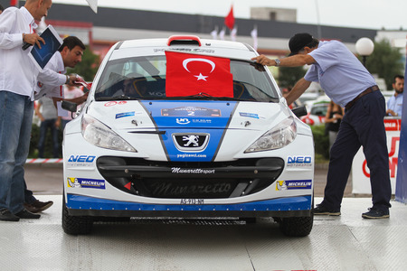 KOCAELI, TURKEY - AUGUST 22, 2015: Yagiz Avci with Peugeot 207 S2000 of Neo Motorspor Team in ceremonial start of Kocaeli Rally 2015