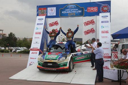 turkiye: KOCAELI, TURKEY - AUGUST 23, 2015: Murat Bostanci with Ford Fiesta S2000 of Castrol Ford Team Turkiye in Podium Ceremony of Kocaeli Rally 2015