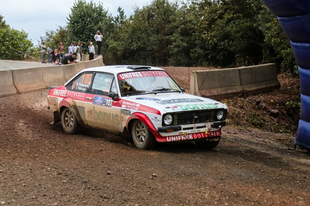 escort: KOCAELI, TURKEY - AUGUST 23, 2015: Hannu Pulkkinen with Ford Escort MK2 of Bonus Unifree Parkur Racing Team in Kocaeli Rally 2015 Editorial