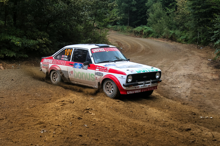 kap: KOCAELI, TURKEY - AUGUST 23, 2015: Engin Kap with Ford Escort MK2 of Bonus Unifree Parkur Racing Team in Kocaeli Rally 2015