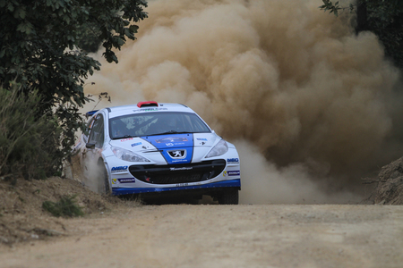 KOCAELI, TURKEY - AUGUST 22, 2015: Yagiz Avci with Peugeot 207 S2000 of Neo Motorspor Team in Kocaeli Rally 2015 Editöryel