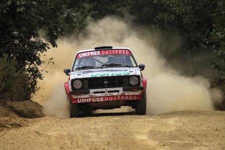 escort: KOCAELI, TURKEY - AUGUST 22, 2015: Hannu Pulkkinen with Ford Escort MK2 of Bonus Unifree Parkur Racing Team in Kocaeli Rally 2015