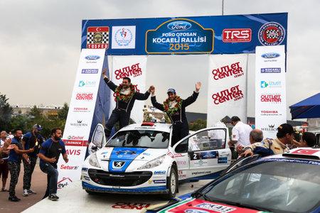 KOCAELI, TURKEY - AUGUST 23, 2015: Yagiz Avci with Peugeot 207 S2000 of Neo Motorspor Team in Podium Ceremony of Kocaeli Rally 2015