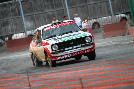 kap: KOCAELI, TURKEY - AUGUST 22, 2015: Engin Kap with Ford Escort MK2 of Bonus Unifree Parkur Racing Team in special stage of Kocaeli Rally 2015 Editorial
