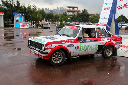 kap: KOCAELI, TURKEY - AUGUST 23, 2015: Engin Kap with Ford Escort MK2 of Bonus Unifree Parkur Racing Team in Podium Ceremony of Kocaeli Rally 2015 Editorial