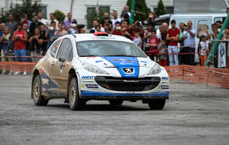 KOCAELI, TURKEY - AUGUST 22, 2015: Yagiz Avci with Peugeot 207 S2000 of Neo Motorspor Team in special stage of Kocaeli Rally 2015 Editöryel