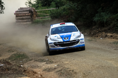 KOCAELI, TURKEY - AUGUST 23, 2015: Yagiz Avci with Peugeot 207 S2000 of Neo Motorspor Team in Kocaeli Rally 2015