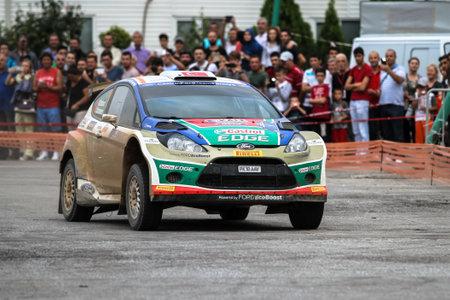 turkiye: KOCAELI, TURKEY - AUGUST 22, 2015: Murat Bostanci with Ford Fiesta S2000 of Castrol Ford Team Turkiye in special stage of Kocaeli Rally 2015