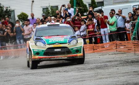 turkiye: KOCAELI, TURKEY - AUGUST 22, 2015: Orhan Avcioglu with Ford Fiesta S2000 of Castrol Ford Team Turkiye in special stage of Kocaeli Rally 2015