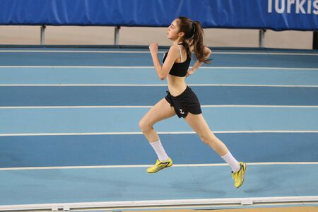 olympic game: ISTANBUL, TURKEY - DECEMBER 12, 2015: Athlete Sema Ozbay runs during Turkish Athletic Federation Olympic Threshold Indoor Competitions