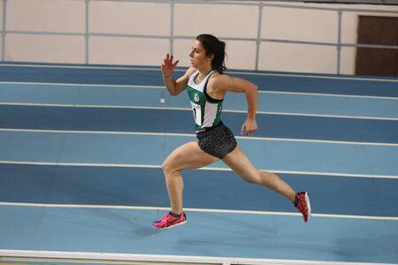 olympic game: ISTANBUL, TURKEY - DECEMBER 12, 2015: Athlete Kubra Celik runs during Turkish Athletic Federation Olympic Threshold Indoor Competitions