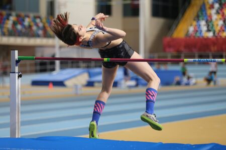 threshold: ISTANBUL, TURKEY - DECEMBER 12, 2015: Athlete Miray Akbulut high jumpes during Turkish Athletic Federation Olympic Threshold Indoor Competitions