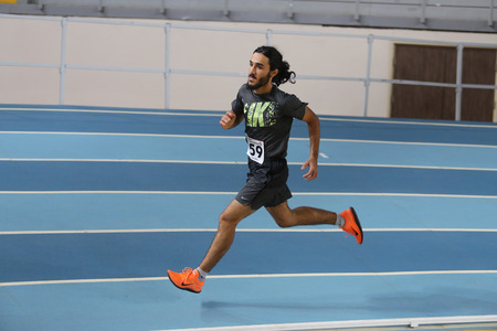 athlete running: ISTANBUL, TURKEY - DECEMBER 12, 2015: Athlete Anil Akgul runs during Turkish Athletic Federation Olympic Threshold Indoor Competitions