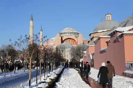 hagiasophia: ISTANBUL, TURKEY - JANUARY 01, 2016: Sultanahmet square and Hagia Sophia covered with first snow of season. Hagia Sophia was built in 537 than converted into a mosque in 1453 and museum in 1935.