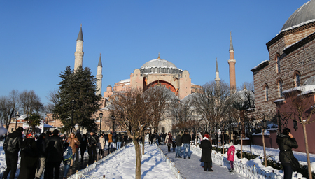 ISTANBUL, TURKEY - JANUARY 01, 2016: Sultanahmet square and Hagia Sophia covered with first snow of season. Hagia Sophia was built in 537 than converted into a mosque in 1453 and museum in 1935.