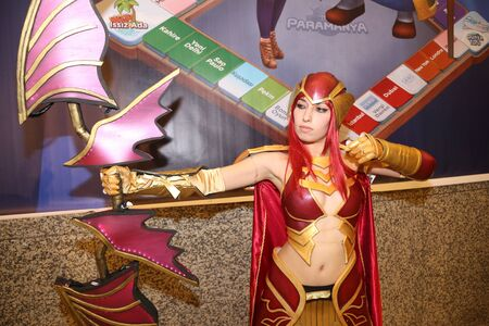 archer cartoon: ISTANBUL, TURKEY - DECEMBER 20, 2015: Cosplayer girl in Knight Online Archer costume during Gamex game fair in Lutfi Kirdar International Convention and Exhibition Center