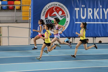 threshold: ISTANBUL, TURKEY - JANUARY 10, 2016: Athletes running during Turkish Athletic Federation Olympic Threshold Indoor Competitions Editorial