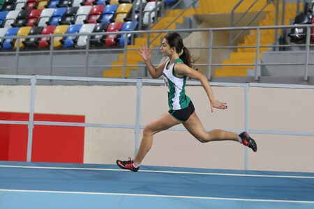 olympic game: ISTANBUL, TURKEY - DECEMBER 26, 2015: Athlete Irmak Gultekin runs during Turkish Athletic Federation Indoor Athletics Record Attempt Races Editorial