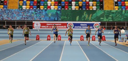 metres: ISTANBUL, TURKEY - DECEMBER 26, 2015: Athletes run 60 metres race during Turkish Athletic Federation Indoor Athletics Record Attempt Races