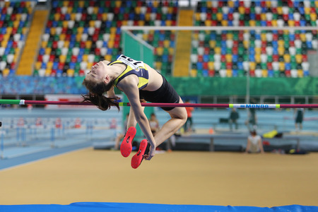 olympic game: ISTANBUL, TURKEY - JANUARY 10, 2016: Athlete Emine Selda Kirdemir high jumpes during Turkish Athletic Federation Olympic Threshold Indoor Competitions
