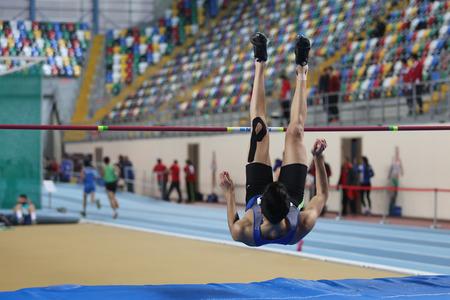 ramazan: ISTANBUL, TURKEY - DECEMBER 26, 2015: Athlete Ramazan Can high jumpes during Turkish Athletic Federation Indoor Athletics Record Attempt Races