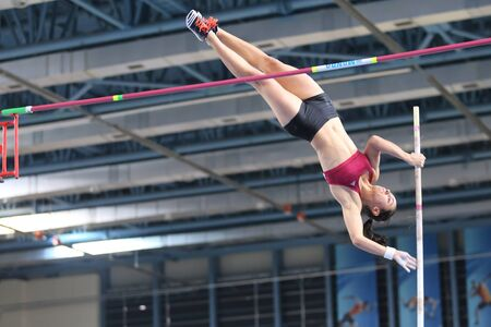 ISTANBUL, TURKEY - DECEMBER 26, 2015: Athlete Demet Parlak pole vaulting during Turkish Athletic Federation Indoor Athletics Record Attempt Races