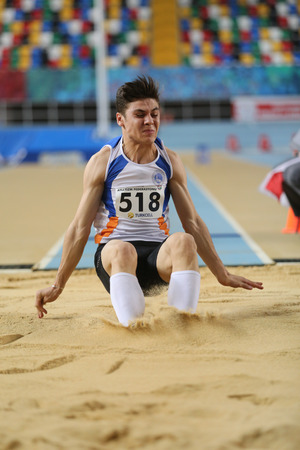 ISTANBUL, TURKEY - DECEMBER 26, 2015: Athlete Abdulkadir Kacar long jumpes during Turkish Athletic Federation Indoor Athletics Record Attempt Races