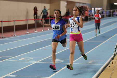 olympic game: ISTANBUL, TURKEY - DECEMBER 26, 2015: Athletes run during Turkish Athletic Federation Indoor Athletics Record Attempt Races