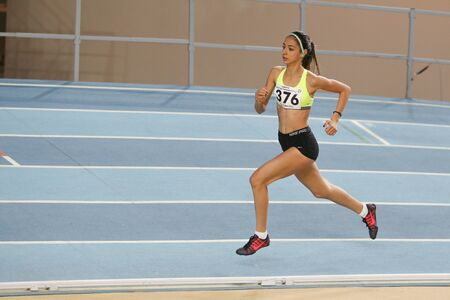 olympic game: ISTANBUL, TURKEY - DECEMBER 26, 2015: Athlete Semra Karaslan runs during Turkish Athletic Federation Indoor Athletics Record Attempt Races Editorial