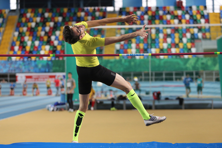 ISTANBUL, TURKEY - DECEMBER 26, 2015: Athlete Samed Gunar high jumpes during Turkish Athletic Federation Indoor Athletics Record Attempt Races
