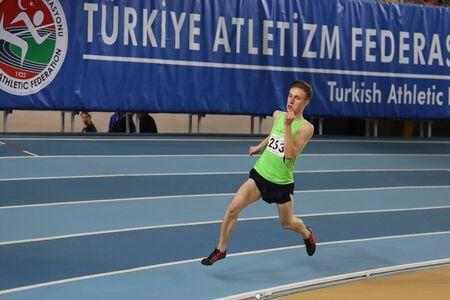 threshold: ISTANBUL, TURKEY - JANUARY 10, 2016: Athlete Sercan Basim runs during Turkish Athletic Federation Olympic Threshold Indoor Competitions