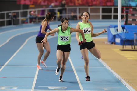 relay race: ISTANBUL, TURKEY - DECEMBER 26, 2015: Athletes run 4x400 relay race during Turkish Athletic Federation Indoor Athletics Record Attempt Races
