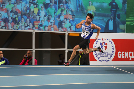 ISTANBUL, TURKEY - DECEMBER 26, 2015: Athlete Serhat Deniz runs during Turkish Athletic Federation Indoor Athletics Record Attempt Races Editorial