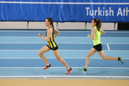 olympic game: ISTANBUL, TURKEY - JANUARY 10, 2016: Athletes running during Turkish Athletic Federation Olympic Threshold Indoor Competitions Editorial