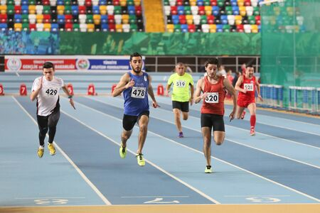 olympic game: ISTANBUL, TURKEY - DECEMBER 26, 2015: Athletes run 60 metres race during Turkish Athletic Federation Indoor Athletics Record Attempt Races