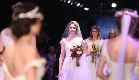 the latest models: ISTANBUL, TURKEY - JANUARY 15, 2016: Models showcase the latest creations of Banu Guven during Fashionist Fair.