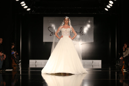 ISTANBUL, TURKEY - JANUARY 31, 2016: A model showcases one of the latest creations of Seren Moda during Weeding Fair.