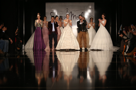 the latest models: ISTANBUL, TURKEY - JANUARY 31, 2016: Models showcase the latest creations of Seren Moda during Weeding Fair. Editorial