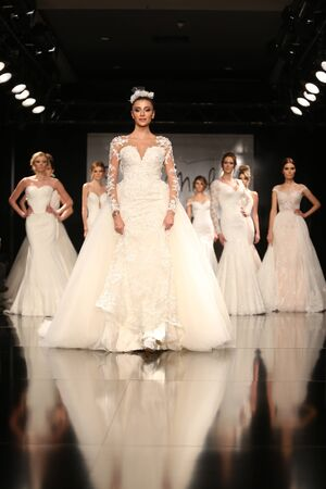 ISTANBUL, TURKEY - JANUARY 31, 2016: Models showcase the latest creations of Seren Moda during Weeding Fair. Editorial