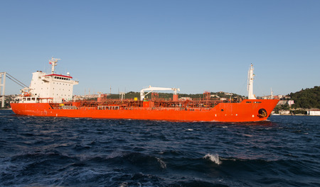 tanker ship: Orange Tanker Ship Passing in Bosphorus Strait