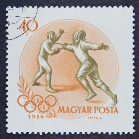 postmail: HUNGARY - CIRCA 1956: A stamp printed in Hungary, shows Fencing in 16th Olympic Games at Melbourne series