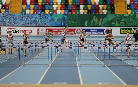 steeplechase: ISTANBUL, TURKEY - FEBRUARY 06, 2016: Athletes running steeplechase during Turkish Athletic Federation Clubs Indoor Championship