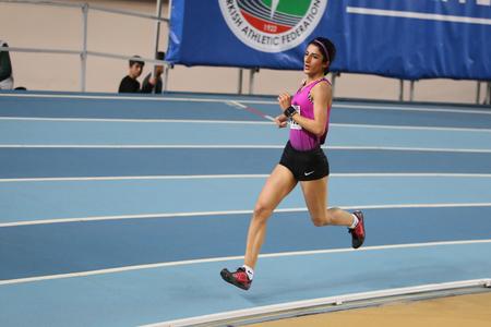 olympic game: ISTANBUL, TURKEY - FEBRUARY 21, 2016: Athlete Yayla Kilic running during Turkcell Turkish Indoor Athletics Championships
