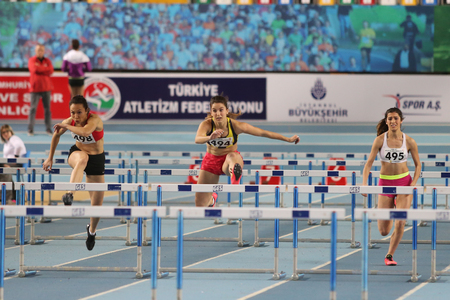 steeplechase: ISTANBUL, TURKEY - FEBRUARY 21, 2016: Athletes running steeplechase during Turkcell Turkish Indoor Athletics Championships