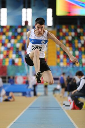 ramazan: ISTANBUL, TURKEY - FEBRUARY 21, 2016: Athlete Ramazan Senkal triple jumps during Turkcell Turkish Indoor Athletics Championships