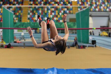 olympic game: ISTANBUL, TURKEY - FEBRUARY 21, 2016: Athlete Nursena Sengoz high jumps during Turkcell Turkish Indoor Athletics Championships