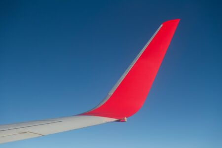 thy: ISTANBUL, TURKEY - JULY 15, 2014: Boeing 737-800 wing and wingtip device during Turkish Airlines Boeing 737-800 flight. THY is the national flag carrier airline of Turkey with 258 fleet size.