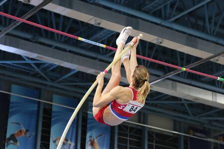 vaulting: ISTANBUL, TURKEY - FEBRUARY 27, 2016: Athlete Jelena Damnjanovic pole vaulting in Balkan Athletics Indoor Championships