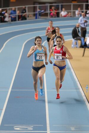 olympic game: ISTANBUL, TURKEY - FEBRUARY 27, 2016: Athletes running in Balkan Athletics Indoor Championships Editorial
